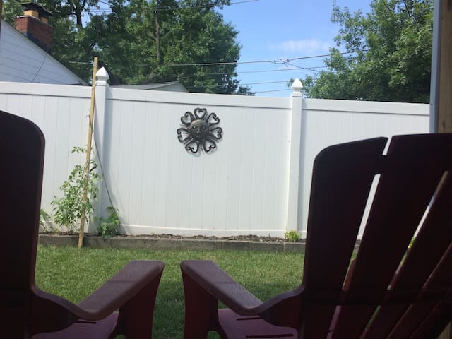 Relax in an Adirondack chair in the back yard