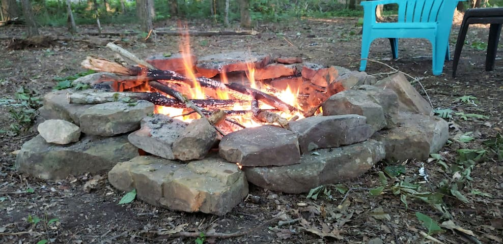 Love the smell of a campfire? It's that time of the year & there is one just waiting for you! Campfire wood is plentiful & fire starter provided.  S'mores and campfires are perfect for relaxing in the woods.  Just in time for beautiful Fall colors!