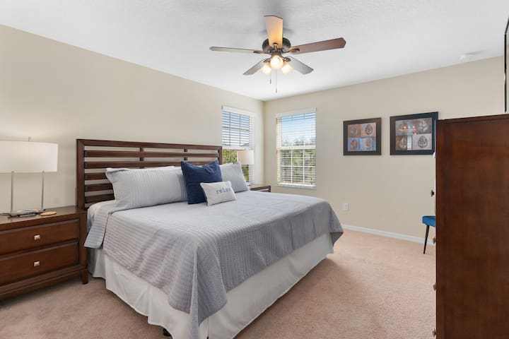 """The second floor master bedroom features a King size bed with memory foam, a 43"""" Roku enabled TV, walk-in closet with pack n play and sound machine & private attached bath."""