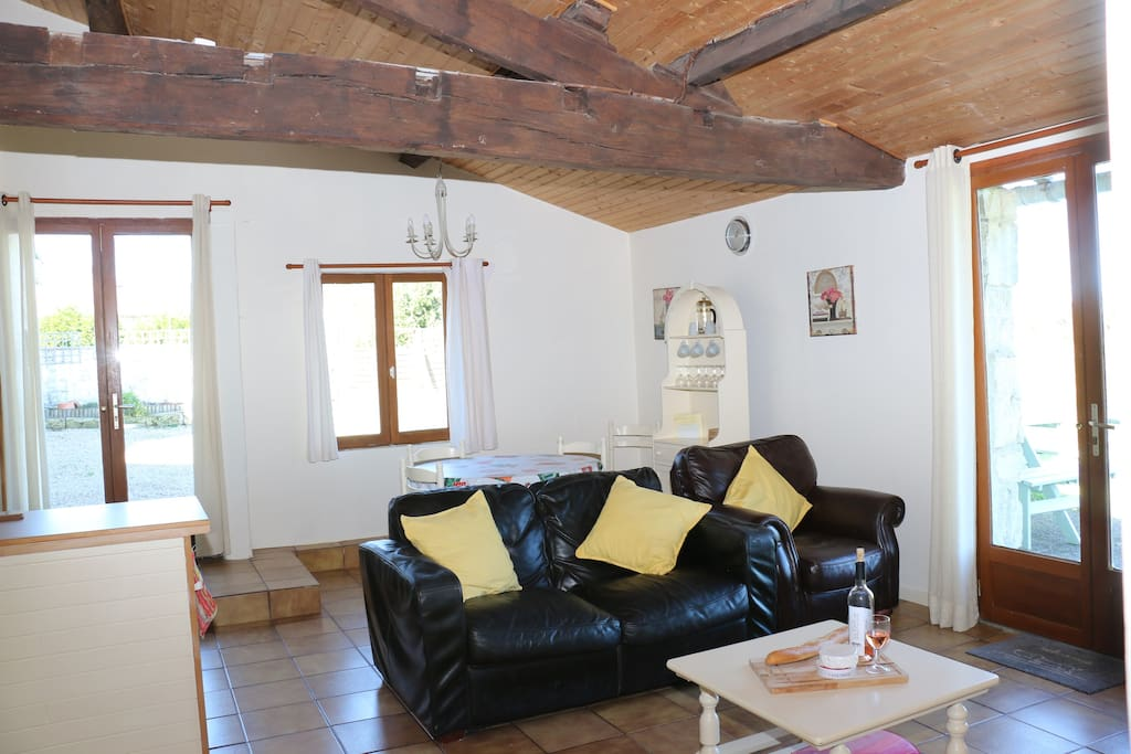 Wonderful open plan space with character wooden beams, a log burner and fantastic views