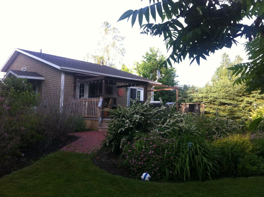 Enjoy BBQing on the deck overlooking a beautifully landscaped yard.