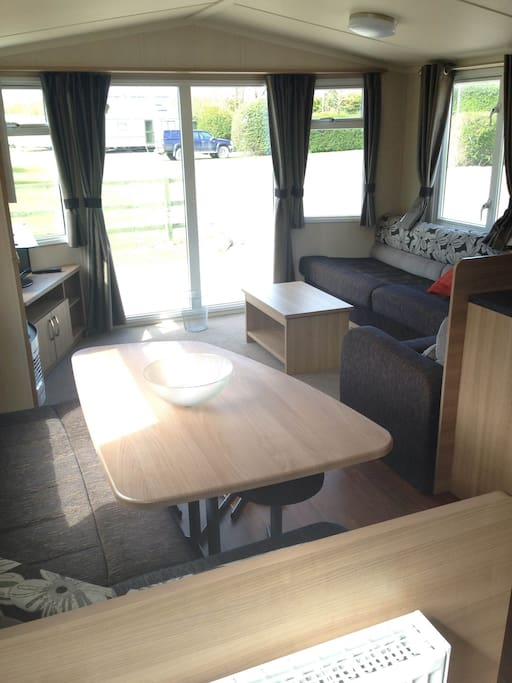 Large windows let in plenty of light, giving the caravan a light and airy feel
