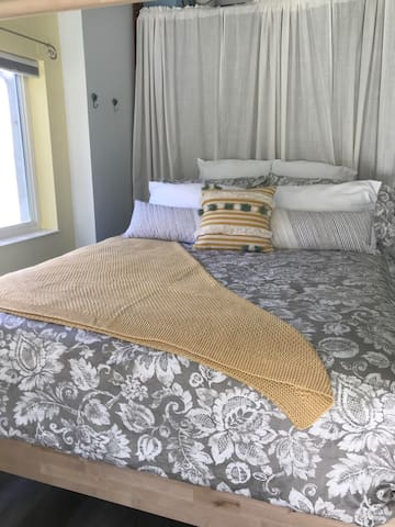 Queen bed with comfy mattress.