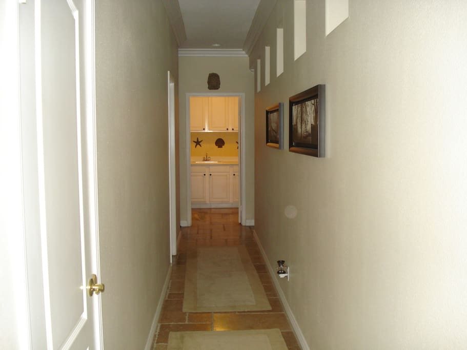 Hallway leading to the laundry and private bathroom/bedroom
