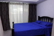 1 bedroom with firm Queen size mattress, floor to ceiling glass and balcony with sunset view.