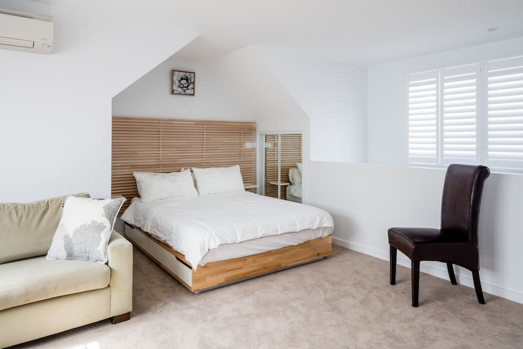 Comfy Queen bed with bed side wardrobes providing plenty of storage for two.