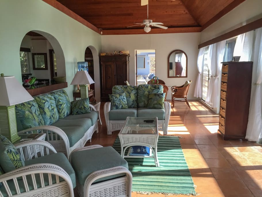 The comfortable living and dining rooms features views of the ocean.