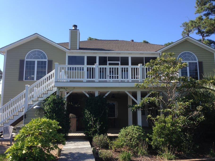 Backyard overlooking the intercostal waterway and Bogue Sound. Underneath patio has outdoor kitchen for family entertaining plus an outdoor shower.