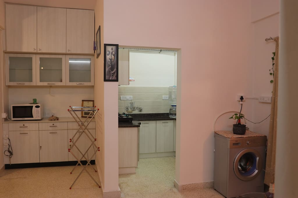 Utilities( Microwave, Iron , Drying Stand and Washing Machine & Dryer) Kitchen Entrance.