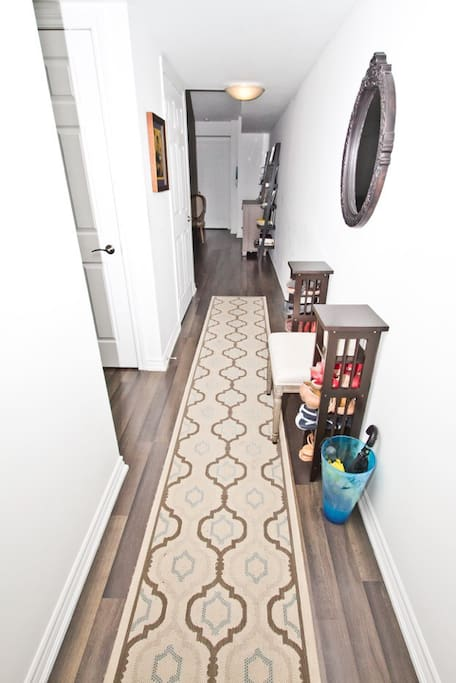 Welcome to this lovely 2 bedroom, 2 full bathroom unit - with this long hallway separating the bedrooms to ensure quiet sleeps.