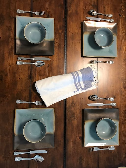 Modern rustic dining table & stoneware constructed dinnerware.
