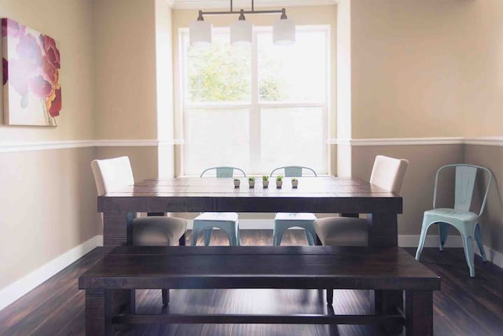A bench, and a total of six other chairs gives the whole family plenty of room at this big dining table for eating together or playing board games.