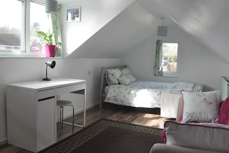 Light airy double loft room.