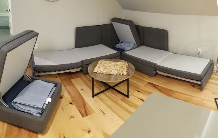 Couch opens to 2 twin beds, all linens  included