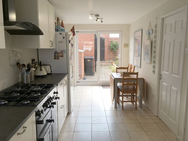 Kitchen with patio door leading out into back patio garden