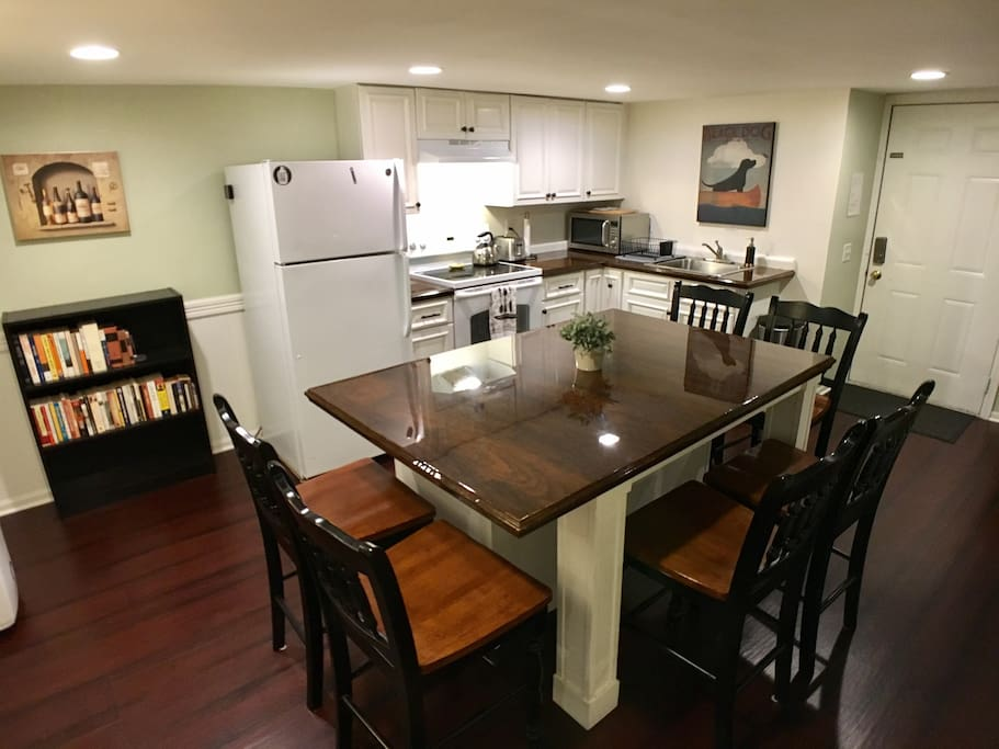 Open kitchen with center island in this 1300 sq ft basement apartment [renovated 09/2016]