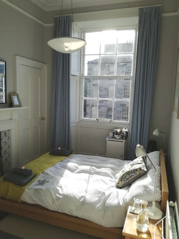 Lovely sunny bedroom to relax in