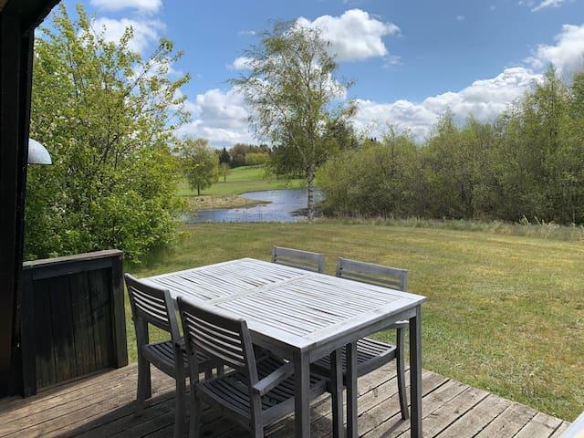 Golfhus i Himmerland...Udsigt til hul 12 og søen.