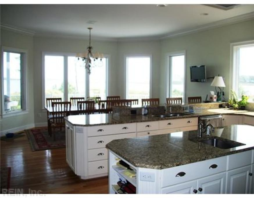 Large well stocked gourmet kitchen with loads of counter space