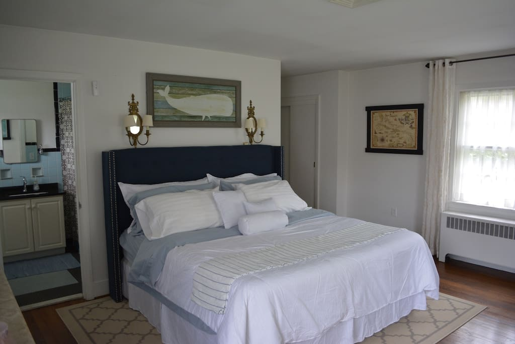 Guest Suite:  Crisp white linens on King Sized Bed