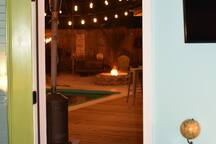 Open the door and enjoy a view of a nighttime fire from your bed.