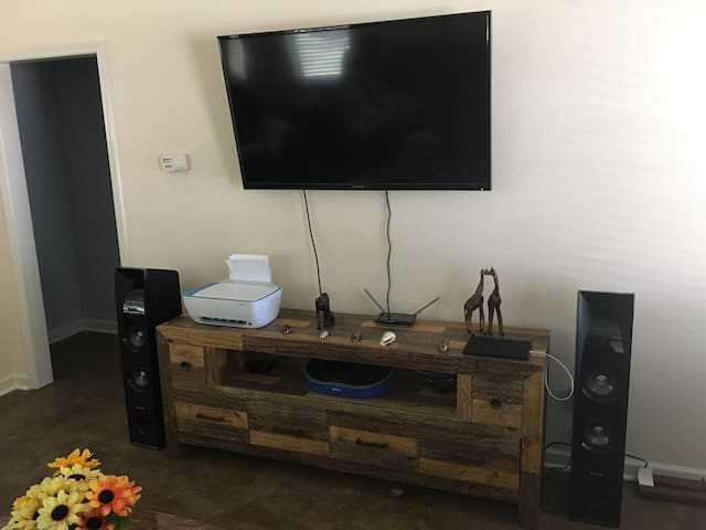 55 inch HD TV connected to Apple TV. Two large bluetooth Samsung speakers connect to Apple TV upon arrival. You can also pair the speakers with your bluetooth devices as well. Printer will be available upon request.