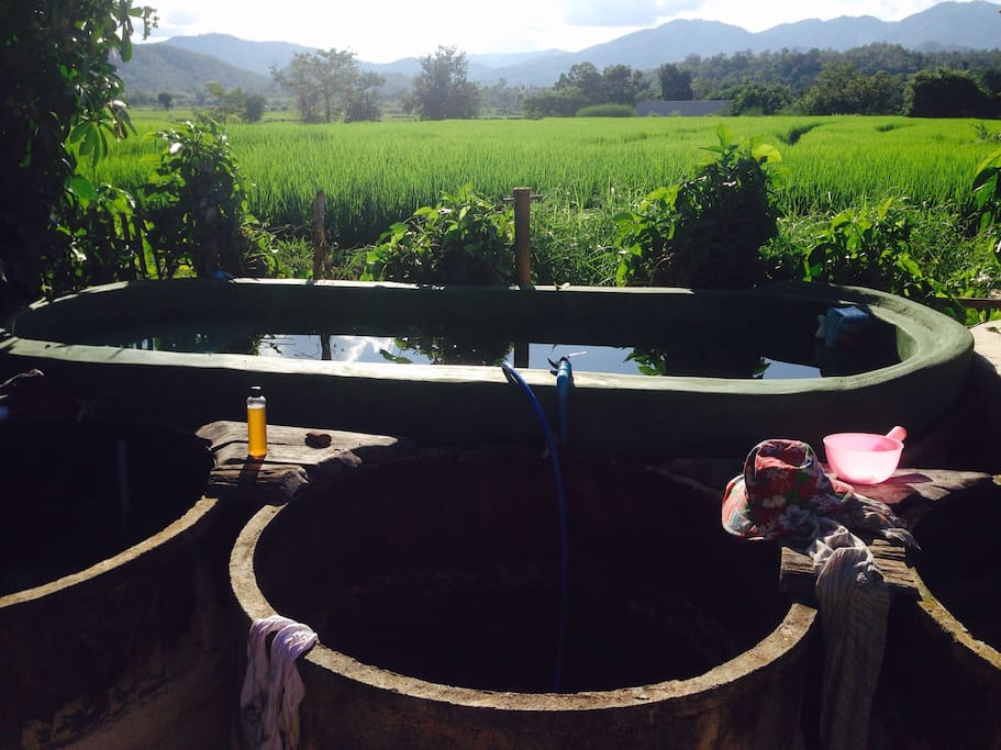 pool overlooking paddies and smaller tubs for a quick bath or a full spa experience with water on different temperatures
