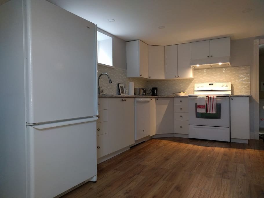 Bright and spacious kitchen, with induction cooktop and microwave.