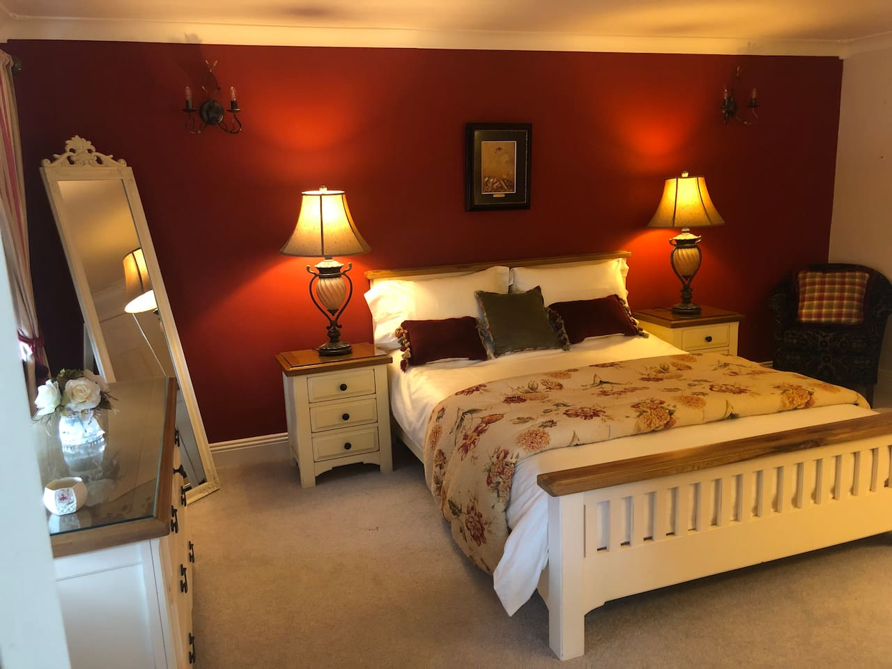 Relaxing spacious double room with ample storage.