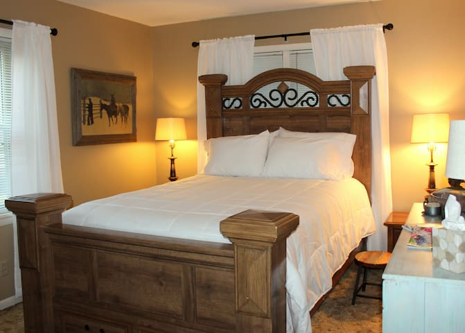 """The single queen bed guestroom is light and bright and has a closet for storing luggage and hanging clothing.   We use hotel quality white linens, and guests describe the beds as, """"wonderfully comfortable."""""""