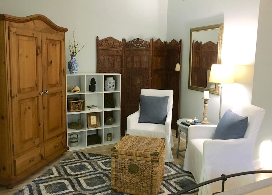 Cozy sitting area:   Flat screen TV/DVD located in the large armoire can be watched from the sitting area or the bed