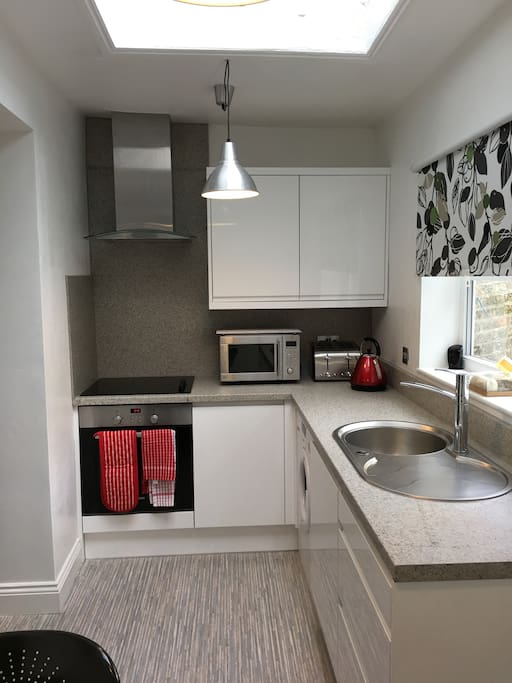 Kitchen with Fully integrated oven, microwave, toaster, kettle and chimney