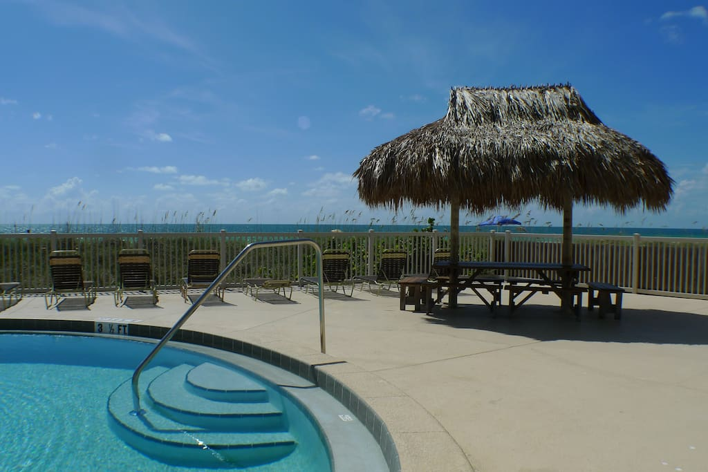 Take a dip in our pool while watching the Gulf of Mexico