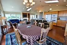 Dining table for eight with spectacular ocean views and a door leading out to wrap around deck.