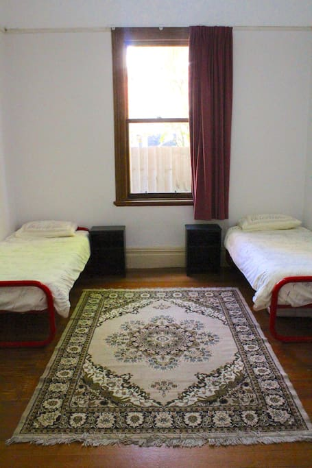 This is a simple but pleasant room with two single beds and a desk and chair for your use.
