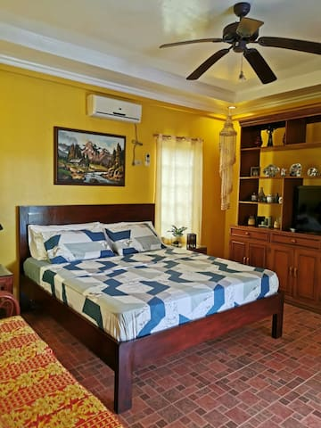 ROOM A. Located at ground floor. 1 King Sized bed.  This room has the best view, however, it does not have its own toilet and bathroom but is located just right outside the bedroom.