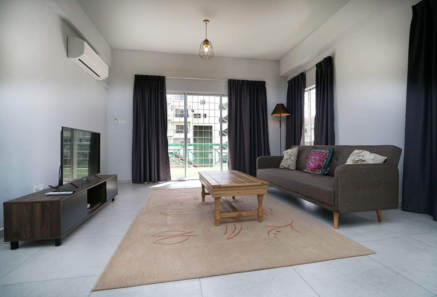 Living room with aircond, fan, flat screen LED tv, free wifi, sofa bed, dinning table for 8, balcony and wide space.