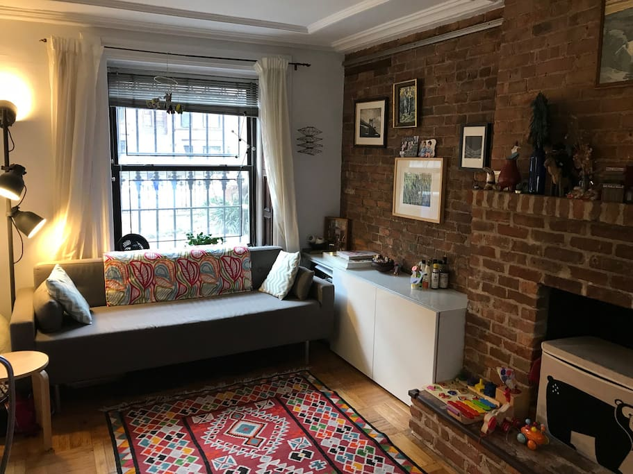 Window in living room looks out onto picturesque brownstone block