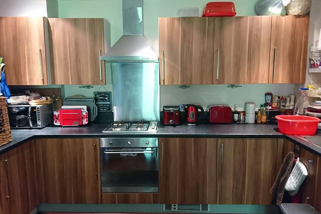 Kitchen area with fridge freezer, oven, washing machine and dishwasher