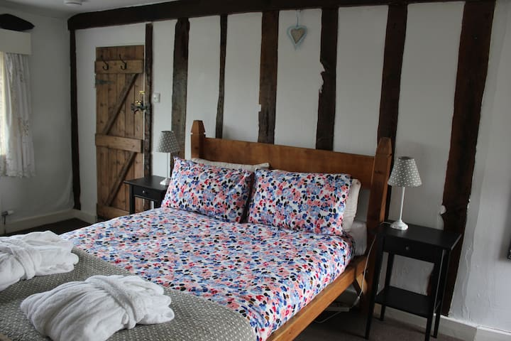 The Apprentice Room with handmade oak bed