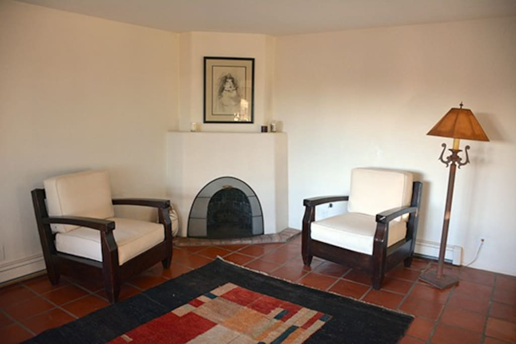 The Sitting Room is a separate area for conversation. This Gas-Fired Fireplace requires only the flick of a switch and a lighter. Please shut off the gas when finished.