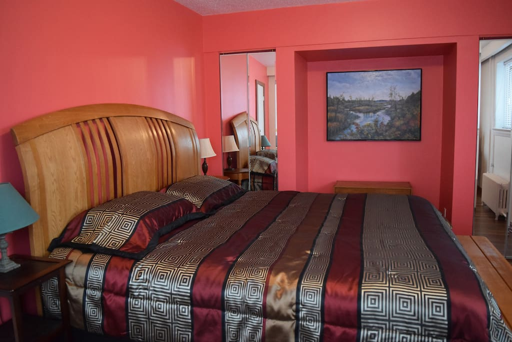 A King size bed in a comfortable room.