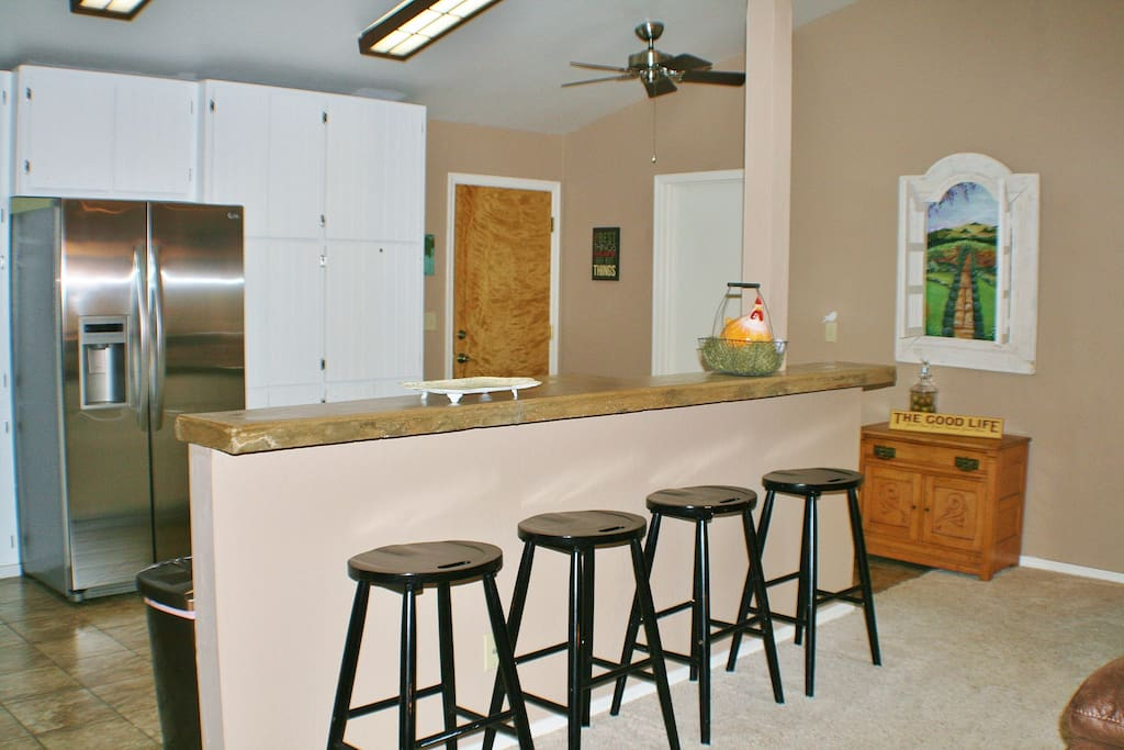 Bar seating for four.  Entertain your guests while cooking up a meal in the newly renovated kitchen.