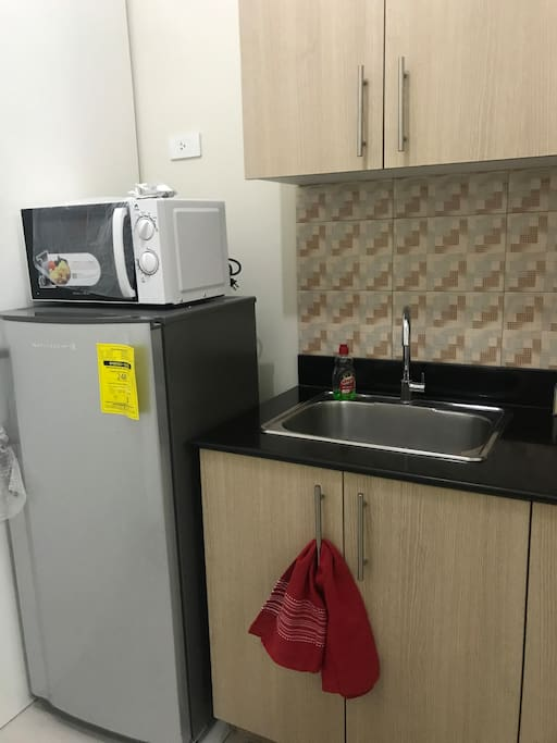 Kitchen with ref, microwave and electric stove