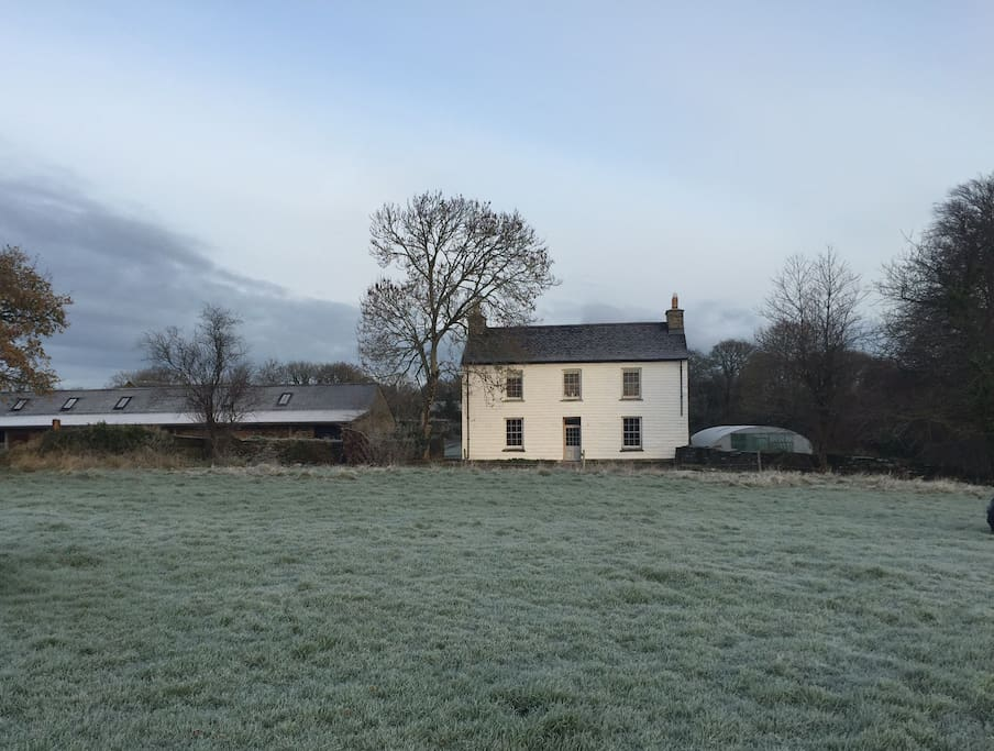 The restored Georgian Farmhouse overlooking the Welsh hills & countryside.