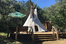 The tee pee without painting and a rain cap.