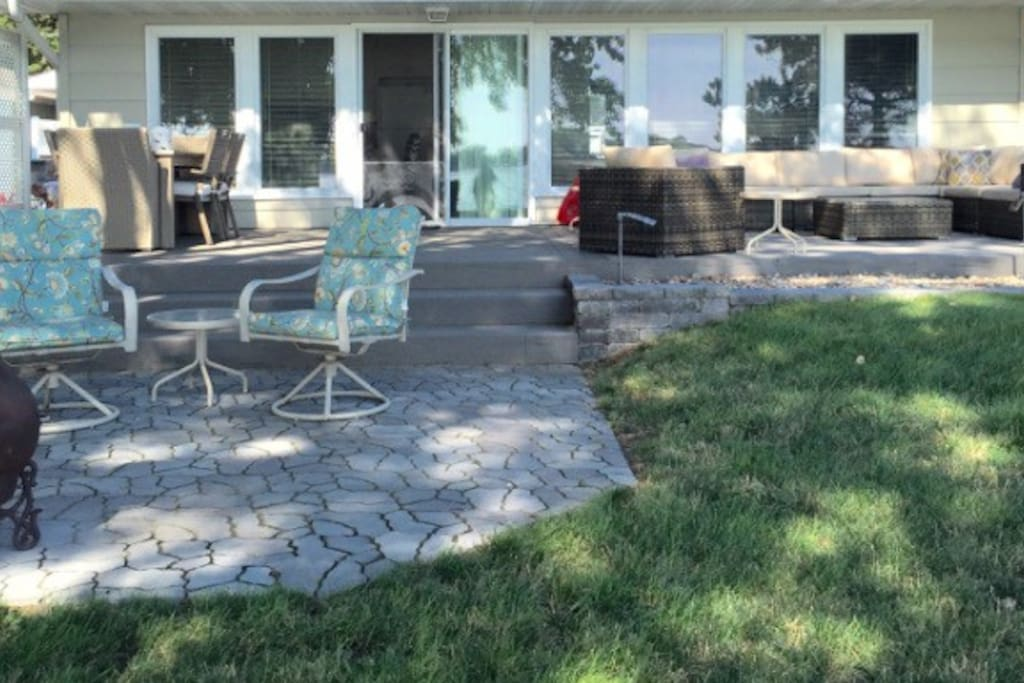 Outdoor Living Area, Nice Shade with sectional seating for 8, and outdoor dining for 6, and fire pit area with gorgeous view of lake.