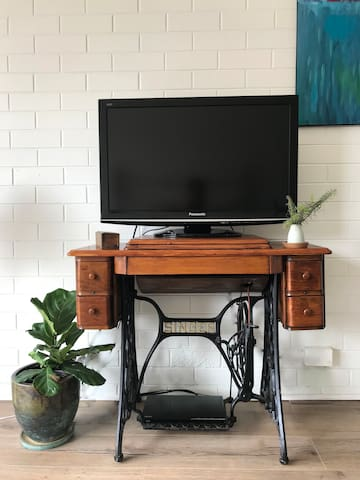 Television and DVD Player - Perfect to Watch From Anywhere in the Studio. Many DVD's available to choose from. Netflix Access Available through the DVD player.