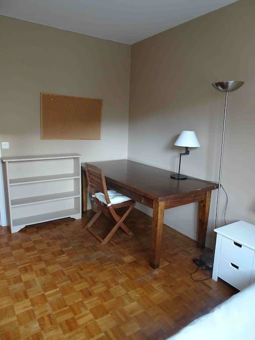 large desk and plenty of storage in bedroom