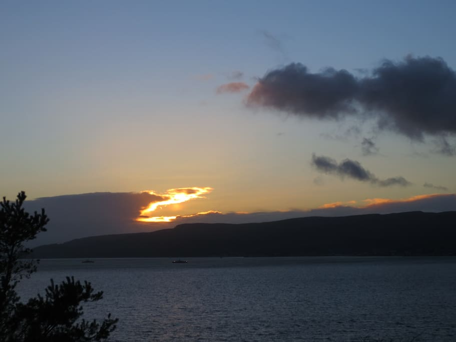 Sunset over The Cowal Peninsula. Viewed from living room.